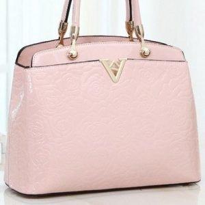Vaaleanpunainen kultakoristeinen laukku